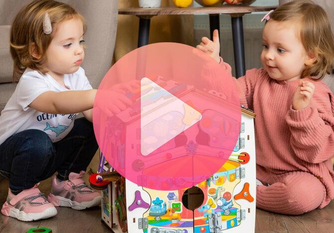 Видео обзор Бизиборд домик развивающий Смайлики на аттракционе 30х35 см со светом